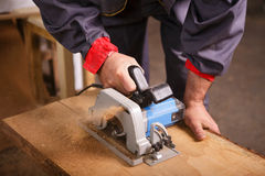 Hands carpenter working with a circular saw Stock Photo