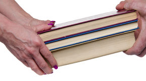 Hands carrying books Royalty Free Stock Photo