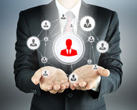 Hands carrying businessman icon network - HR, MLM & team work concepts Royalty Free Stock Photo