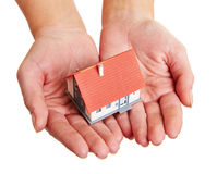 Hands carrying small house Stock Photos
