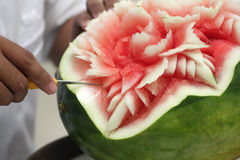 Hands carved watermelon Stock Images