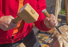 Hands of carver at work Royalty Free Stock Image
