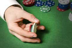 Hands with casino chips Stock Photos