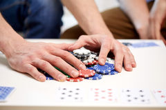 Hands with casino chips making bet or taking win Stock Photo