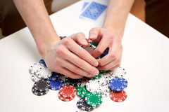 Hands with casino chips making bet or taking win Royalty Free Stock Photos