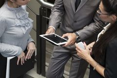 Hands of a casual man holding a digital tablet. Royalty Free Stock Images