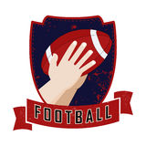 Hands catches ball. Illustration of an american football player catching a ball. Grunge retro style logo Royalty Free Stock Images
