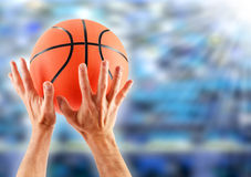 Hands catching basketball Royalty Free Stock Images