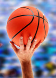 Hands catching basketball Royalty Free Stock Image