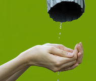 Hands catching clean falling water Stock Photos