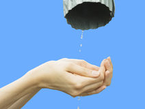 Hands catching clean falling water Royalty Free Stock Images