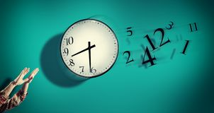Hands catching a clock with numbers detached in the air. stock photography