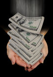 Hands catching falling dollars Stock Photo