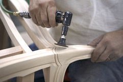 Hands of caucasian craftsman sanding furniture Royalty Free Stock Photos