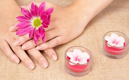 Hands of a caucasian woman with manicure Stock Photos