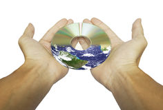 Hands and CD or DVD. Earth motive with CD or DVD disk in hands and white background Stock Image