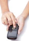 Hands on cellphone typing SMS Royalty Free Stock Image
