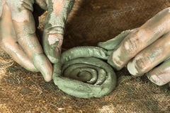 Hands of ceramist creating a craft from blue clay Royalty Free Stock Photo