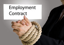 Hands in chain with employment contract banner. Businesswoman with hands in chain holds banner on which stands ´employment contract Royalty Free Stock Photo