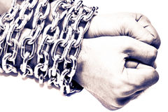 Hands chained in a chain Stock Photos