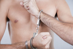 Hands chained in handcuffs Royalty Free Stock Images