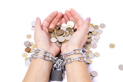 Hands chained to the bank the money saved Stock Photo