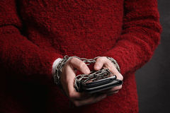 Hands chained to smartphone Royalty Free Stock Images