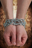 Hands chained together Stock Image