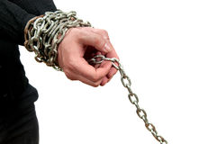 Hands in chains. Man's hands in chains isolated on white Stock Photo