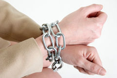 Hands in chains Stock Photo