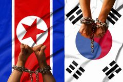 The hands of the chains against the background of the flag of North Korea, DPRK, South Korea Stock Images