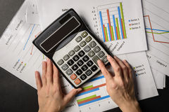 Hands with charts papers and calculator Royalty Free Stock Photography