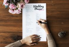 Hands Checking on Wedding Planner Checklist Stock Images