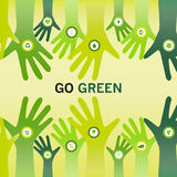Hands cheering Go Green for eco friendly and sustainable world o. Hands decorated with a bio icon and cheering the slogan Go Green for an eco friendly and Stock Photography