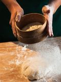 Hands of a chef baker woman kneading dough stock photo