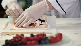 Hands of chef preparing dessert. stock video