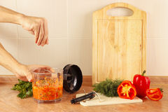 Hands of chef salt cooked vegetable salsa in blender Stock Photos
