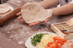 Hands chef sculpts pastry for tacos Stock Photos