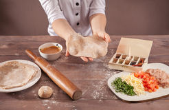 Hands chef sculpts pastry for tacos Royalty Free Stock Image