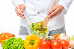 Hands of chef stirred a delicious vegetable salad Stock Photos