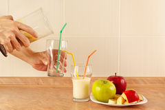 Hands chefs poured fruit smoothie in glasses Stock Photography