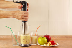 Hands chefs prepared fruit smoothie in blender Royalty Free Stock Photography