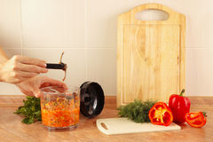 Hands chefs remove knife blender after cooking vegetable mix Stock Photos