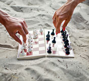 Hands with chess figure making move Royalty Free Stock Images
