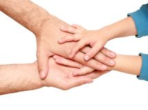 Hands of the child and adult Stock Images