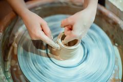 Hands of the child clinging clay pot. Master class on clay model stock image