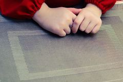 Hands of the child cook on the texture substrate Stock Photography