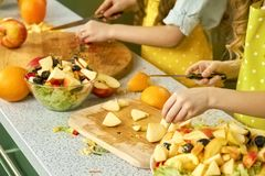 Hands of child cooking. royalty free stock photography
