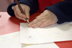 Hands of child by drawing Royalty Free Stock Photography