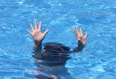 Hands of child drowning Stock Photo